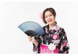 拿折扇的美丽日本女子摄影图片