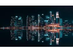 夜景海面城市建筑灯光水面倒影图片