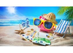海边沙滩戴墨镜粉色小猪存钱罐图片