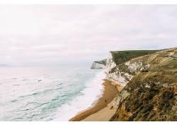 沙滩 岩石与海图片